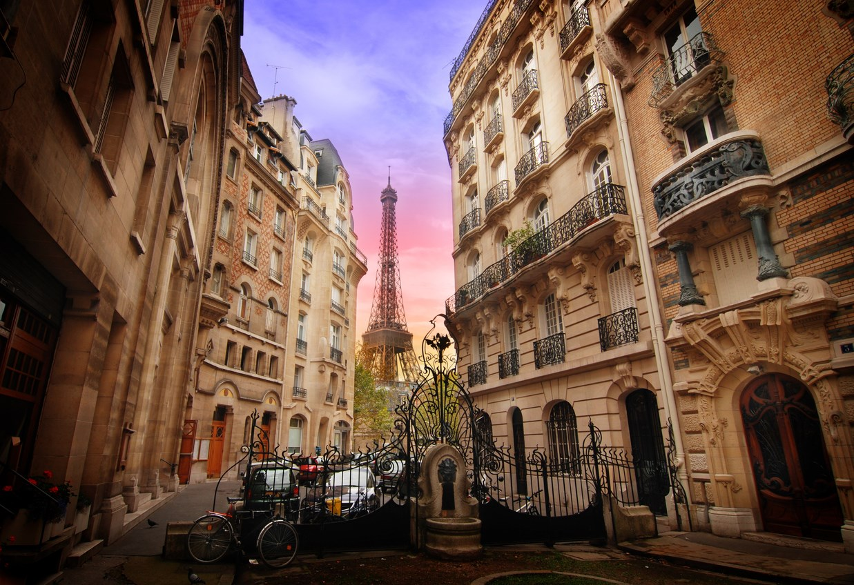 Eiffel Tower view through Paris street