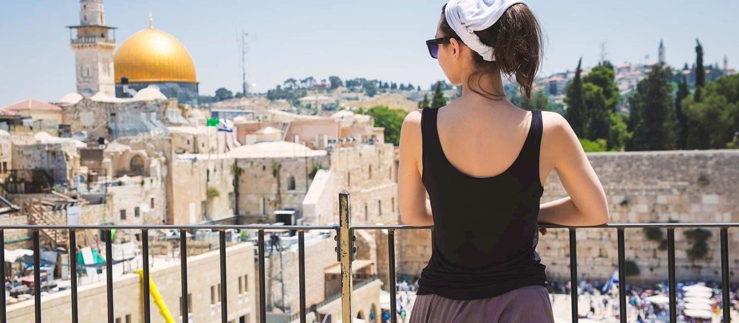 Female Tourist looking at the mosques in Israel